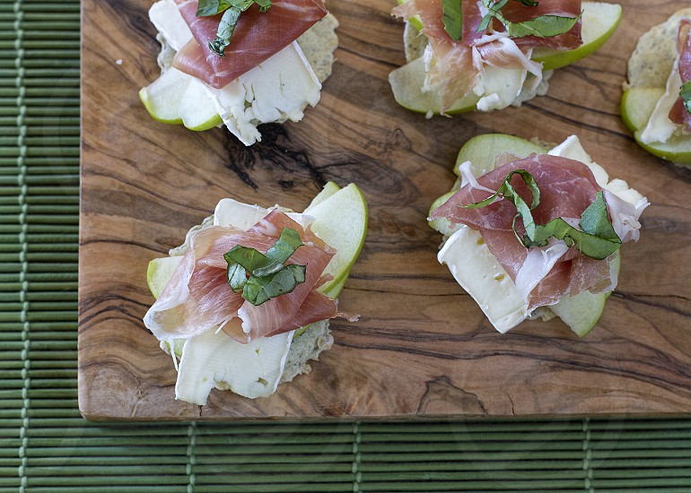 My Favorite Snack Appetizer - Brie Prosciutto Granny Smith Apples and Basil on Crackers photo
