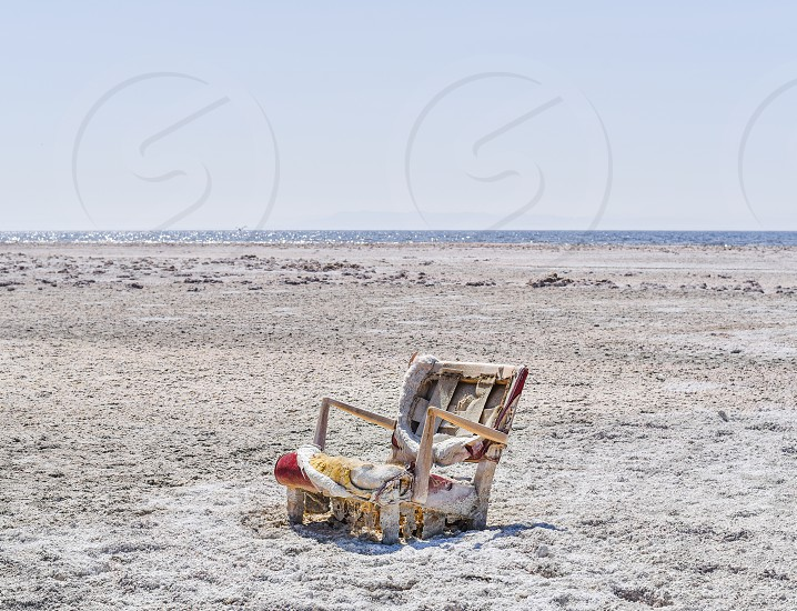 abandoned deserted desert salt salton sea sand california desolate chair seat deteriorated old photo