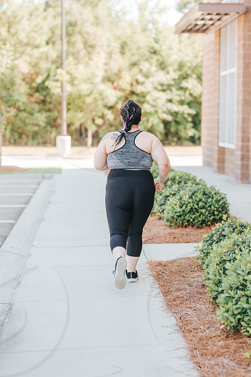 Overweight woman who is working out  photo