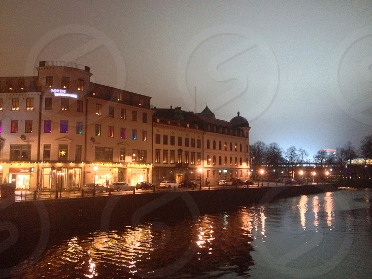 white building beside river photo