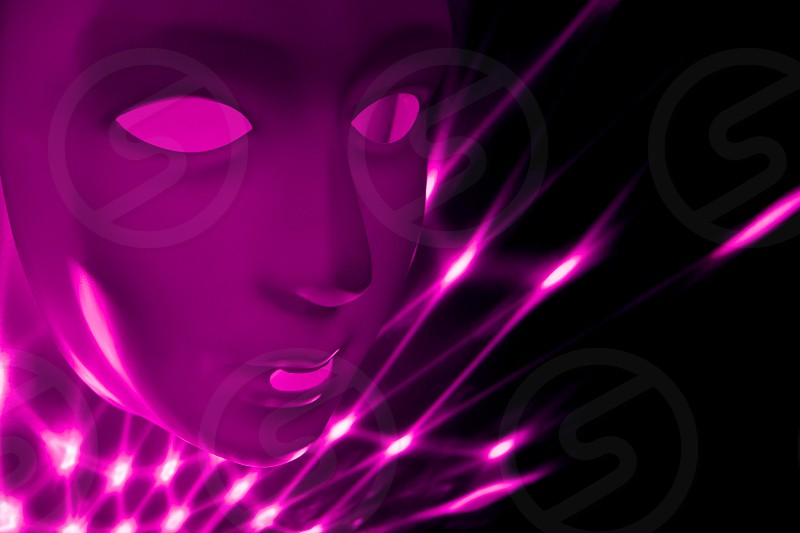 Purple abstract face. Dramatic mask at night. Plastic human mask. Human face on violet black background photo