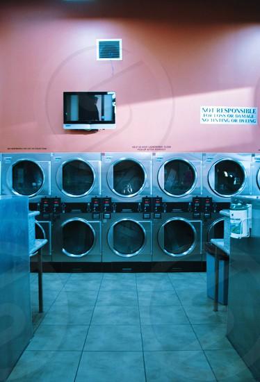 silver metal front load washing machine photo