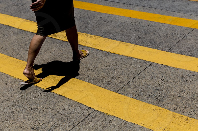 Woman crossing the road in central Hong Kong photo