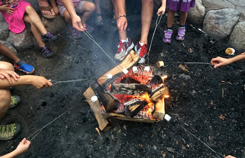 people sitting around bon fire photo