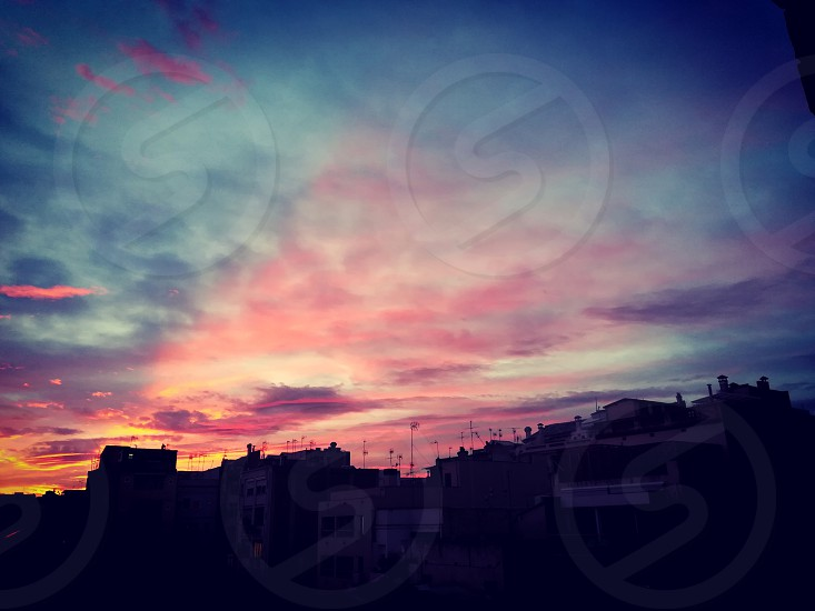 Barcelona Gracia rooftop sunset antenna aerial clouds city landscape photo