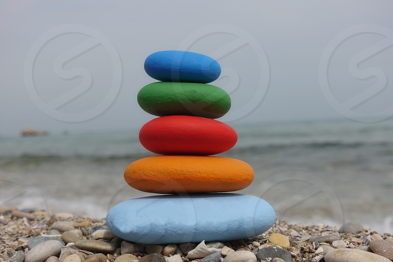 Stack of colored stones on the beach            photo