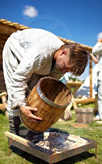 """Moscow Russia - July 7 2012: Moscow historical festival """"Times and epoch"""" in Colomna. Man making barrell. photo"""