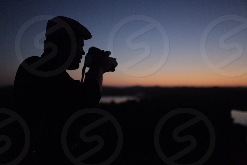 man holding a camera silhouette  photo