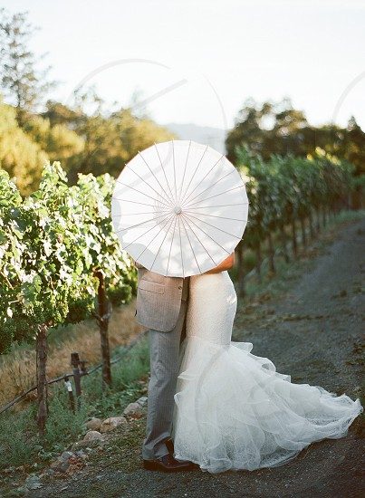 umbrella wedding winery bride and groom photo