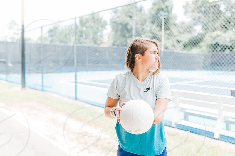 Girl who is missing her forearm playing volleyball photo