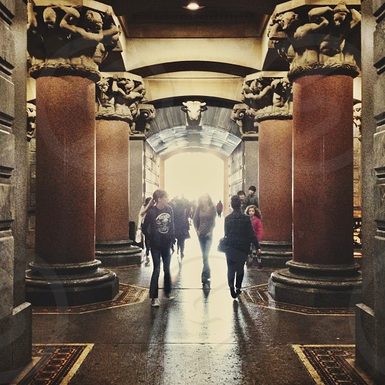 Corridor beneath Philadelphia's City Hall. Columns stone crowd sculpture carvings tile photo