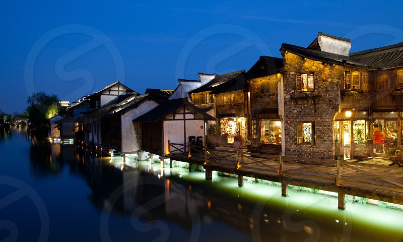 The waterside village in the evening photo