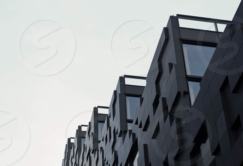 black building under gray sky photo