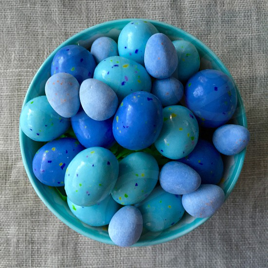 Easter eggs chocolate candy sweets treats blue turquoise violet purple lilac festive spring holiday ceramic bowl linen fabric photo