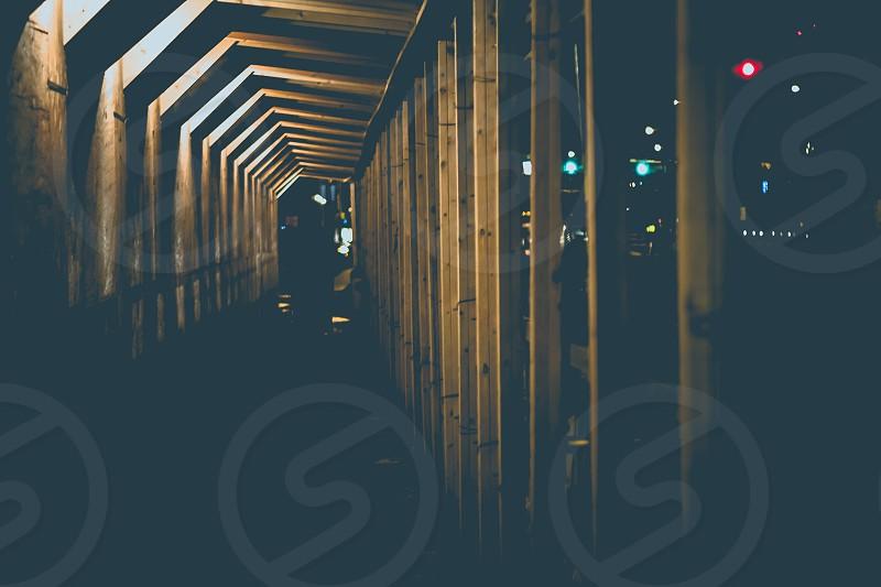columns of wood bracing on hallway photo