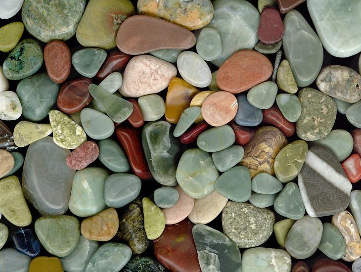 Polished pebbles and semi-precious stones background photo