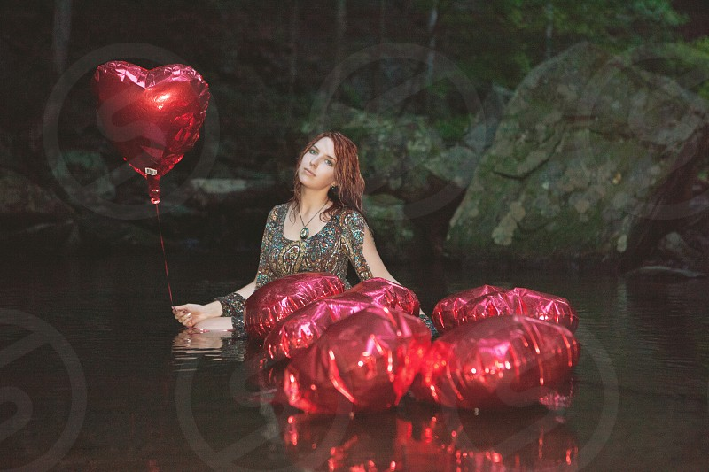 Red heart balloons in the river pool. photo
