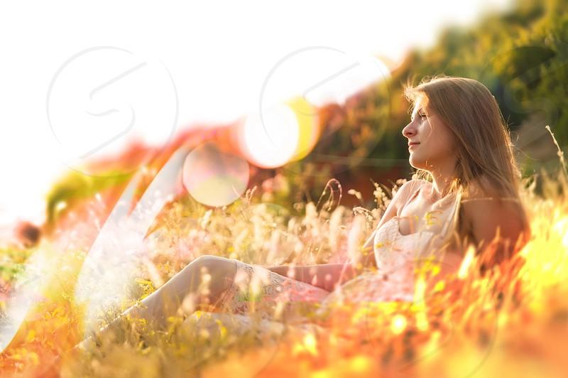 romance dreaming under sunset beautiful woman under sunset  photo