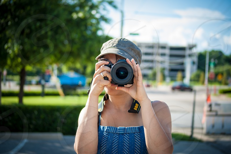 woman taking photo photo