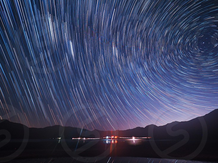 time lapse photography of silhouette of mountain at nighttime photo