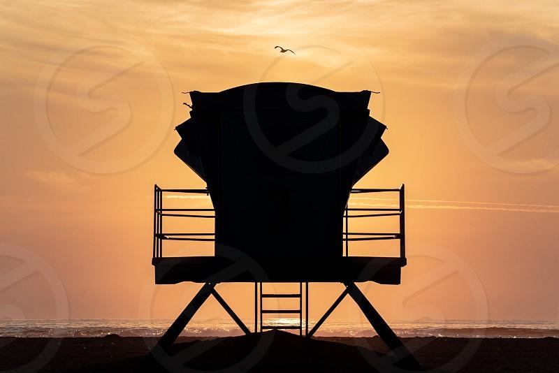 Silhouette lifeguard tower beach sunset orange ocean California pacific pismo sky dusk photo