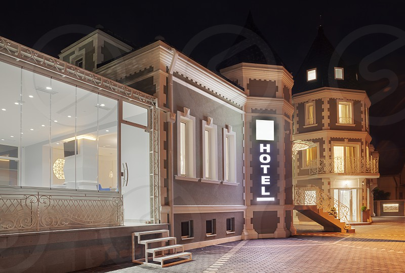Exterior of a modern and new luxury hotel night scene. photo