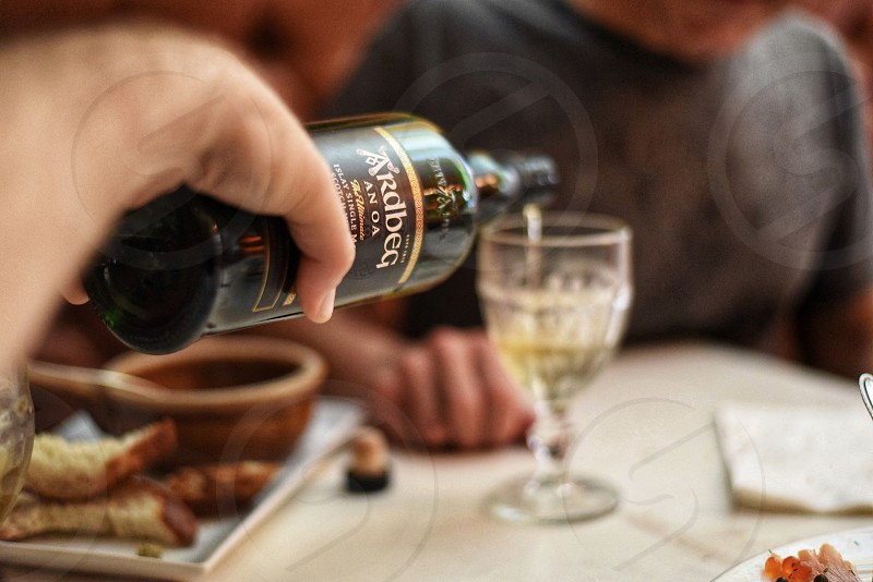 Whiskey POV drinking scotch pouring casual hand photo