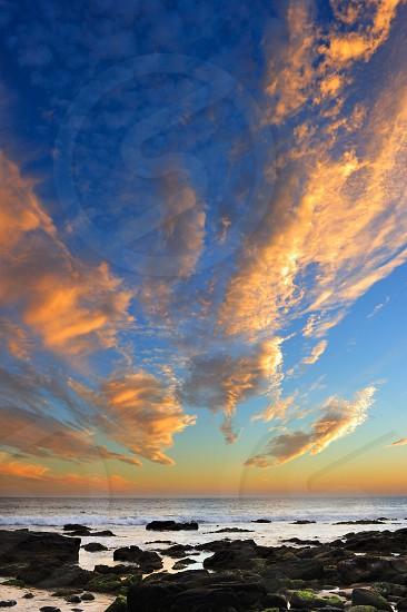 Enjoying sunset in the beach photo
