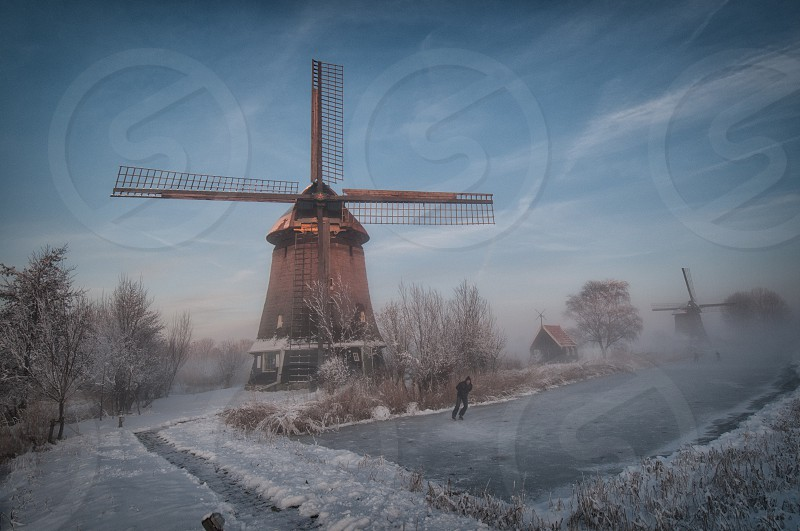 brown windmill on snow photo