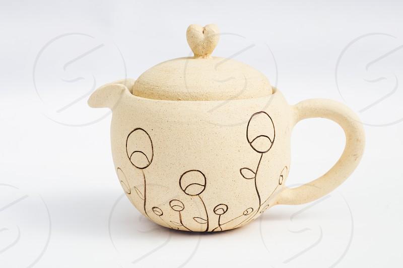 white teapot ceramic stoneware with white background photo