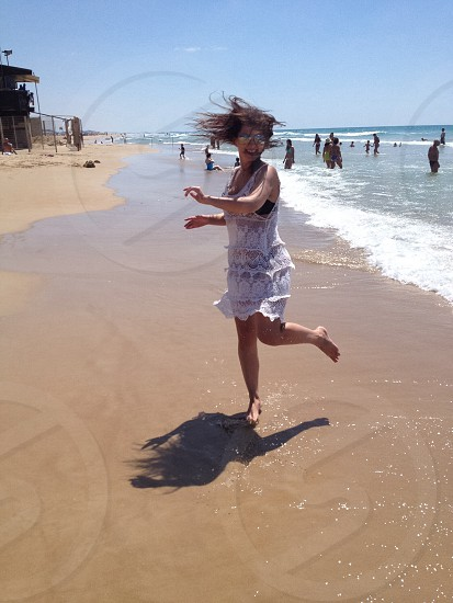 Fun girl beach sea photo