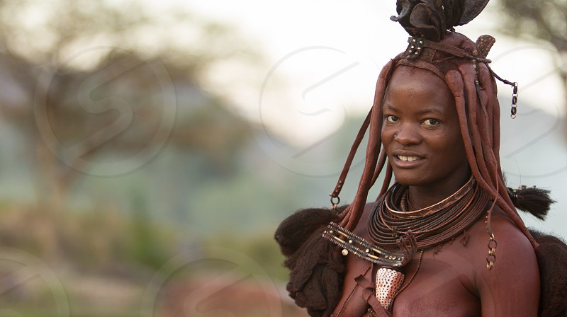 person in tribal accessories smiling photo