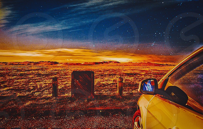 horizon photography of silver car parked near in tombstone photo