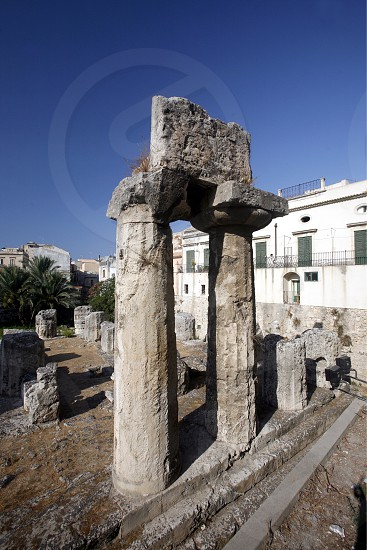 the apollo Temple in the old town of Siracusa in Sicily in south Italy in Europe. photo
