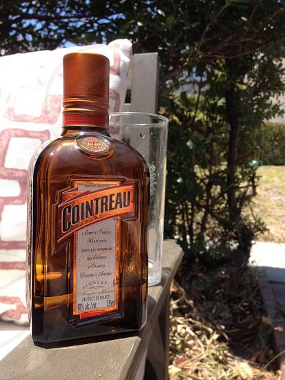 cointreau bottle on chair photo