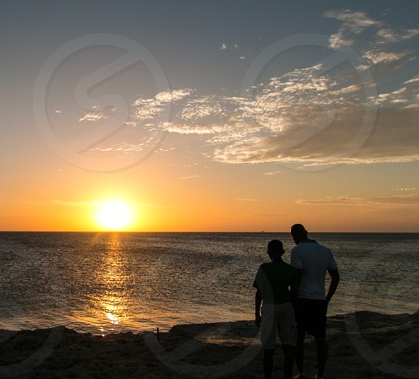 Father son conversation at sunset photo
