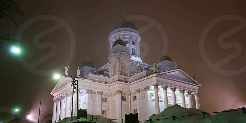 Helsinki Cathedral on foggy winter night in December 2012.  photo