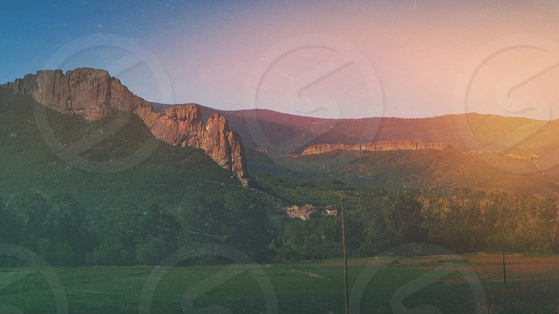 scenic green and brown mountains photo