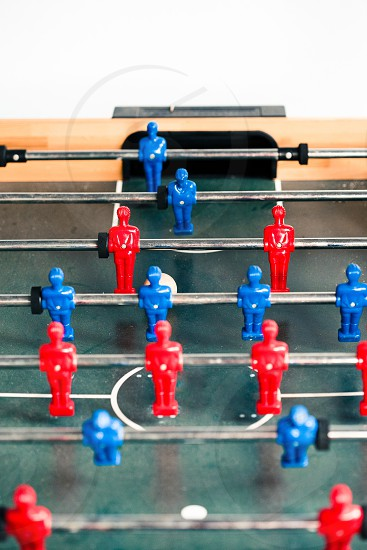 Table football game sport competition two competitors players on field. Closeup of players photo