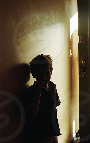 little boy in doorway photo