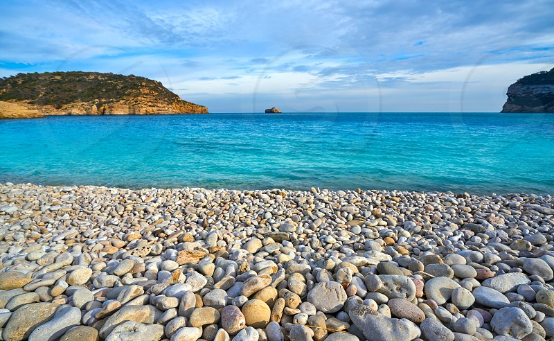 Cala Barraca beach in Xabia Javea rolling stones of Alicante Spain photo