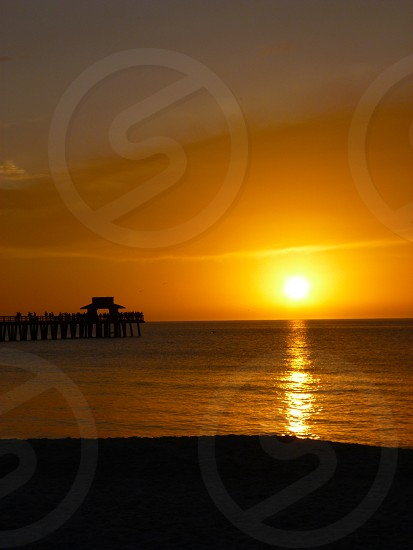 Orange Sunset at the Pier in Naples Florida photo