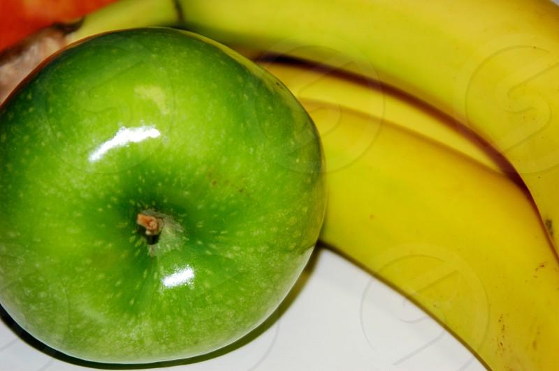 An apple and bananas photo