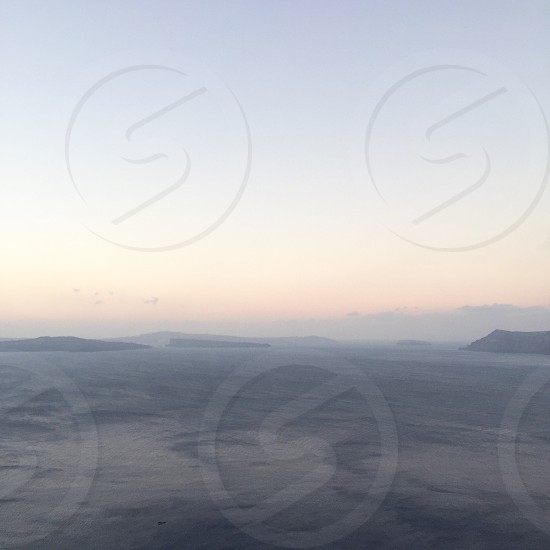 Oia Santorini Greece Greek Islands island destination travel luxury travel morning sunrise luminous view photo