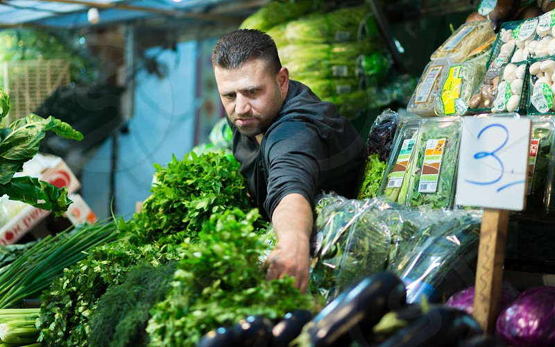 Grocer at the Machane Yehudah Marketplace in Jerusalem photo