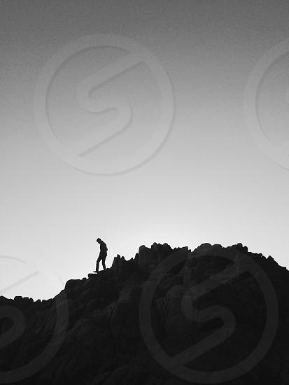 man on hill photo photo