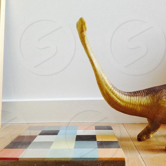brown dinosaur on floor photo