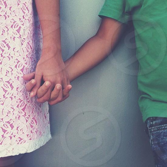 children holding hands photo