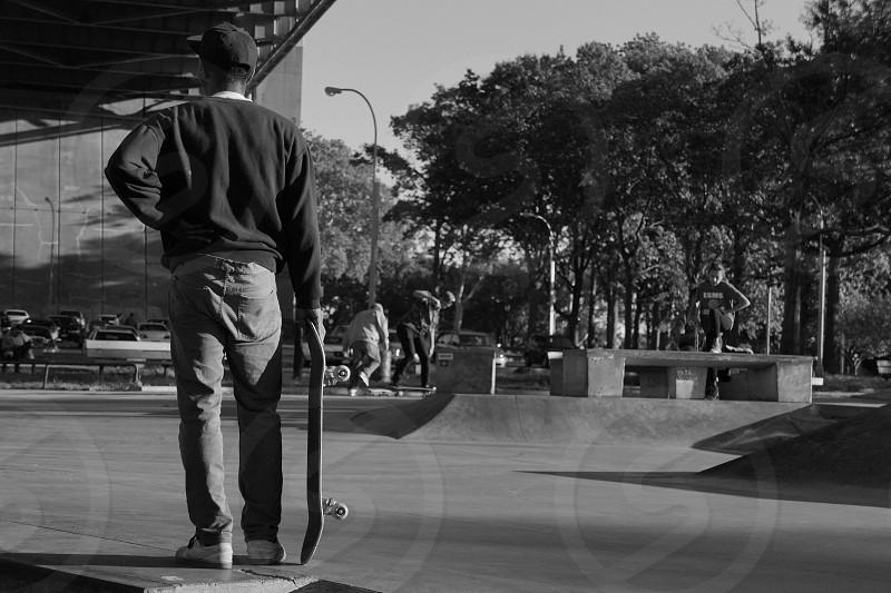 man holding skateboard photo