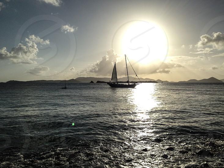 sail on sea during sunrise photo